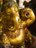 Golden Ganesha God of Riches stock image