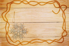Golden garland and snowflake Stock Images