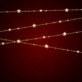 Golden garland with stars Royalty Free Stock Photo