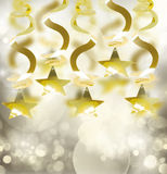 Golden garlands with star. On gray bokeh background Royalty Free Stock Image
