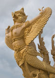 Golden garuda. Golden big garuda on white cloud - in northeast of Thailand Stock Photo