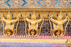 Golden garuda decoration on wall of main Buddhist church or Royalty Free Stock Images