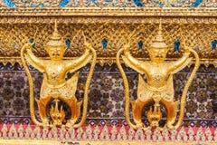 Golden garuda decoration on wall of main Buddhist church or Stock Photos