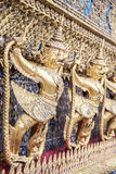 Golden garuda figures at Wat Phra Kaew Temple of the Emerald Buddha in Bangkok royalty free stock image