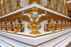 Golden Garuda and Golden Giants. On  wall  in  Thailand temple Stock Photos