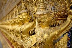 Golden Garuda holding Naga in Wat Prakaew. Royal Grand Palace, Bangkok, Thailand royalty free stock photography