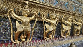 Golden Garuda and Nagas decorate the outside of  Ubosoth of Wat Phra kaew Royalty Free Stock Photo
