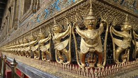 Golden Garuda and Nagas decorate the outside of  Ubosoth of Wat Phra kaew Royalty Free Stock Images