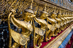 Golden garuda pattern standing at wat pha kaew Royalty Free Stock Image