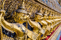 Golden garuda pattern standing at wat pha kaew Royalty Free Stock Photo