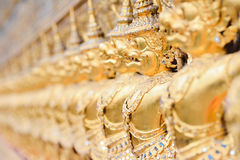 Golden garuda sculpture. Line of golden garuda sculptures Royalty Free Stock Image
