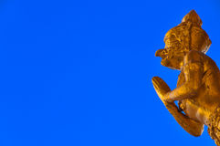Golden garuda statue. With blue background stock images