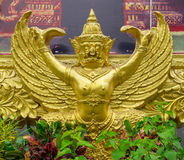 Golden garuda statue under the picture frame Stock Photo