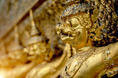 The golden garuda statues stand around main church and hand to l Stock Images