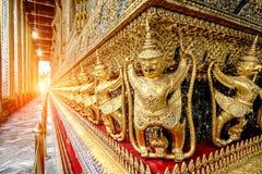 The golden garuda statues stand around main church and hand to l Stock Photo