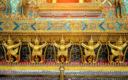 The golden garuda statues stand around main church and hand to l Stock Image