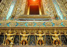 The golden garuda statues stand around main church and hand to l Royalty Free Stock Photo