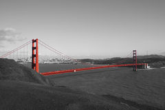 The Golden Gate. Red Golden Gate Bridge with San Francisco in background in black and white Royalty Free Stock Photography