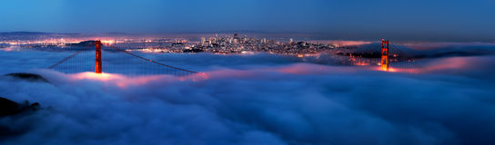 Golden Gate. At night surrounded by fog. This is a very high-resolution panorama Stock Photo