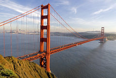 Golden Gate. Sun setting on Golden gate bridge in San Francisco, California Royalty Free Stock Photos