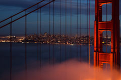 Golden gate bride in front of city stock photography