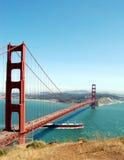 Golden Gate Bridge. A boat sailing under the Golden Gate Bridge Stock Photo