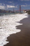Golden Gate Bridge. In the background with tide coming in Royalty Free Stock Photography