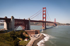 Golden Gate Bridge. Scenic view of red Golden Gate Bridge and historic Fort Point on a sunny day seen from San Francisco, America royalty free stock photography