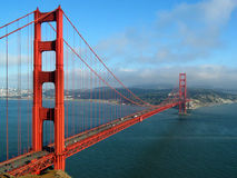Golden Gate Bridge. The Golden Gate Bridge in San Francisco as the evening fog begins to roll in Stock Image
