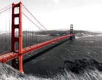 Golden Gate Bridge. The iconic landmark crossing San Francisco Bay seen here red against a black and white photo Royalty Free Stock Images