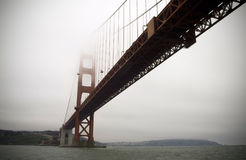 Golden Gate Bridge. View from under the Golden Gate Bridge in fog Royalty Free Stock Photo