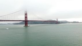 Golden Gate Bridge. Aerial of the Golden Gate Bridge in San Francisco in a misty day. Aerial California, USA stock footage