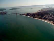 Golden Gate Bridge from the air with San Francisco background stock photos