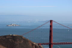 Golden Gate Bridge and Alcatraz. Golden gate Bridge with Alcatraz in the background on a clear blue sky day Stock Photography