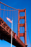 Golden Gate Bridge and America. An American flag in front of the Golden Gate Bridge in San Francisco Royalty Free Stock Photos