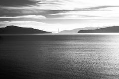 Golden gate bridge. Black and white of golden gate bridge hiding behind the mountains Stock Photo