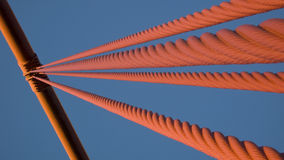 Golden Gate Bridge Cables. An abstract view of the suspension cables on the Golden Gate Bridge in San Francisco. This view plays off the contrast between the Royalty Free Stock Images