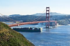 Golden Gate Bridge and Cargo Ship Royalty Free Stock Photos
