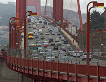 Golden Gate Bridge with cars, buses and people. Close-up. Royalty Free Stock Photo