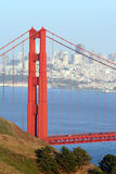 Golden Gate Bridge and City. Telephoto view of Golden Gate bridge from overlook before sunset, against background of the bay and San Francisco city skyscrapers Royalty Free Stock Images