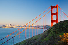 Golden Gate Bridge and city of Sun Francisco. Golden Gate Bridge at sunset, Sun Francisco Royalty Free Stock Images