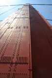 Golden Gate Bridge Close Up. Straight up from the ground of the North Tower of the Golden Gate Bridge royalty free stock photo