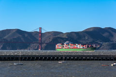 The Golden Gate Bridge and the container ship, San Francisco Bay Stock Images