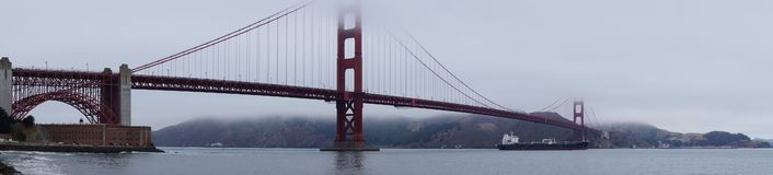 Golden gate bridge covered in clouds royalty free stock image