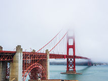 Golden Gate Bridge is covered by fog in San Francisco Royalty Free Stock Photos