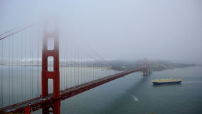 Golden Gate Bridge covered in Fog - Time Lapse. The famous Golden Gate bridge in San Francisco shrouded in fog stock footage