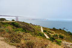 Golden Gate Bridge covered by fog Stock Photography