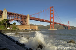Golden Gate Bridge and Crashing Wave Stock Photo