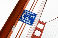 Golden Gate Bridge Crisis Counselling Sign. Suicide Prevention Sign, Golden Gate Bridge, San Francisco, California, USA Royalty Free Stock Image