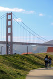 Golden gate bridge - cyclist, biking couple tourists on bike tour enjoying the view at the famous travel landmark in California, S Royalty Free Stock Image